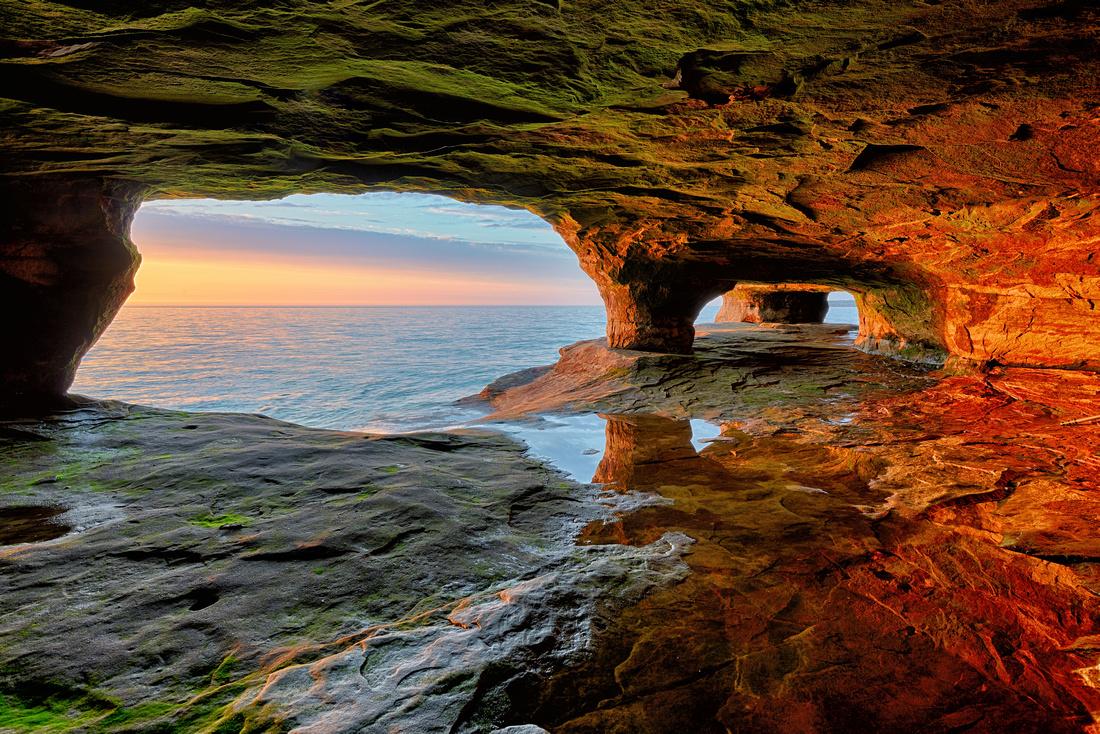 Sunlit Sea cave Lake Superior near Munising, Michigan