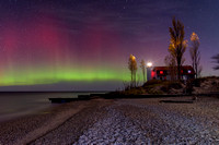 Northern Lights at Point Betise Lighthouse on a moonlit night
