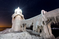 """Fridgid Light""  St Joseph Lighthouse encased in ice under the stars"
